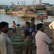Unemployed fishermen loiter near destroyed fishing boats in the Nagapattinam district of Tamil Nadu, India on January 25, 2005, after the area was struck by the Indian Ocean Tsunami on December 26, 2004. Generated by an earthquake on the ocean floor, the tsunami devastated the fishing industry along the southeastern coast of India. .