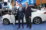 Ryan Seacrest and Alan Mulally, Ford's president and CEO, launch the all new Ford Fusion, America's most fuel-efficient midsize sedan, in Times Square, Tuesday, Sept. 18, 2012 in New York.  (Photo by Diane Bondareff/Invision for Ford)