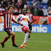 Lloyd Sam, New York Red Bulls, is challenged by Agustin Pelletieri, (left), Chivas USA, during the New York Red Bulls V Chivas USA, Major League Soccer regular season match at Red Bull Arena, Harrison, New Jersey. USA. 30th March 2014. Photo Tim Clayton