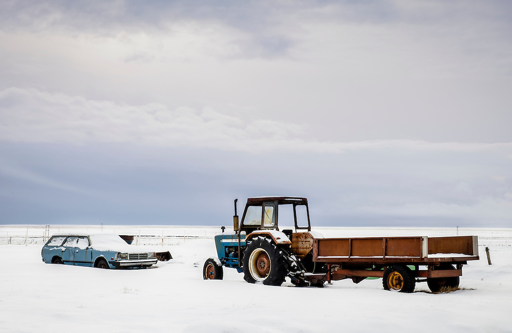 ICELAND - CIRCA MARCH 2015: Old cars covered in snow close to a farrm in South Iceland during winter time.