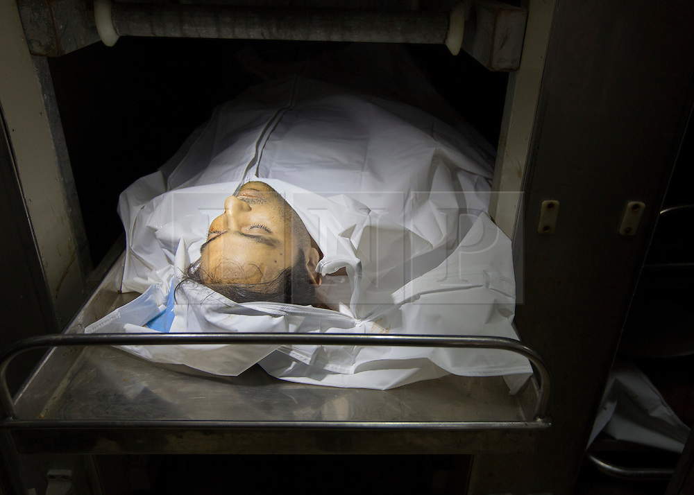 © Licensed to London News Pictures. 17/07/2014. Gaza.   <br /> *WARNING - IMAGE CONTAINS CONTENT OF A GRAPHIC NATURE*<br /> <br /> As the Israel/Gaza conflict enters a 5 hour humanitarian cease fire body of Mohammed Rahman lies in the Gaza morgue after he was killed in an Israeli strike in the Sheikh Ajnein district of Gaza on the 16 Jul 14.  Photo credit : Alison Baskerville/LNP