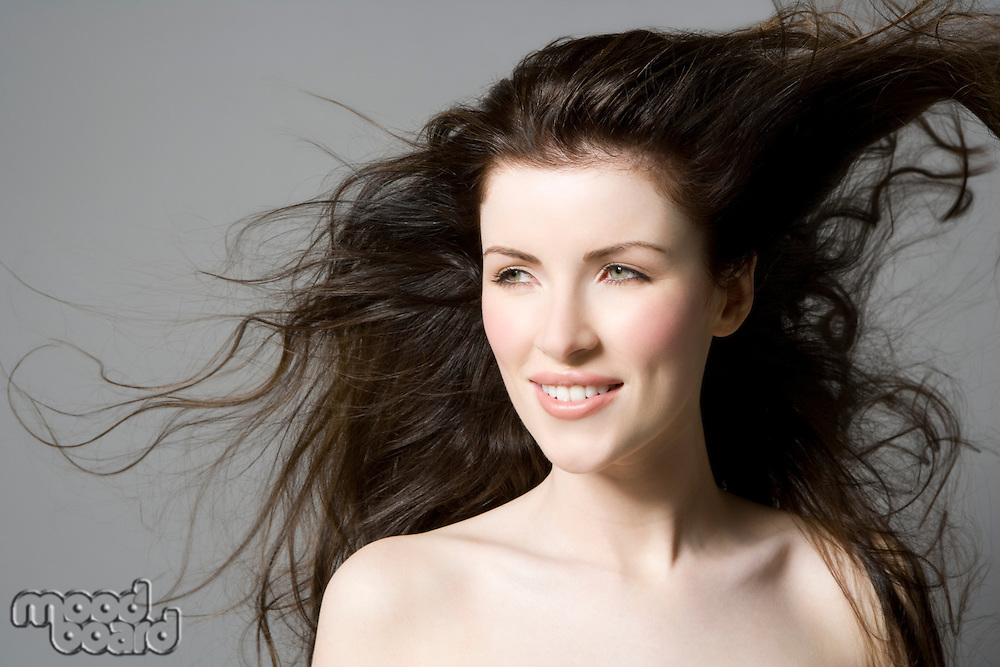 Portrait of woman with wavy brown hair