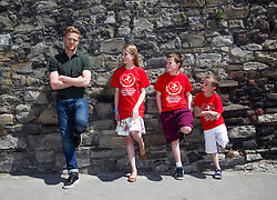 7 June 2013  Damien Duff is pictured with Ciara Sherry (11) from Monaghan, James Mohan (11) from Cabra Co Dublin and Christian Bodie (6) from Dunboyne Heart Children Ireland, a voluntary support group for those affected by congenital heart disorders (CHD), has announced Damien Duff as their new charity ambassador. Damien is father to a young son, Woody, with a congenital heart disorder. Both were in attendance at a event today whereby Heart Children Ireland donated 35 Coagu-Chek machines worth over ?20,000 to the 'Maurice Neligan Congenital Heart Clinic' in the Mater Hospital, Dublin. Picture Andres Poveda