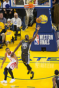 Golden State Warriors forward Draymond Green (23) snags a rebound against the Houston Rockets during Game 4 of the Western Conference Finals at Oracle Arena in Oakland, Calif., on May 22, 2018. (Stan Olszewski/Special to S.F. Examiner)