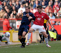 Photo: Leigh Quinnell.<br /> Bristol City v Nottingham Forest. Coca Cola League 1. 31/03/2007. Forests Grant Holt battles with Bristol Citys Phil Jevons.