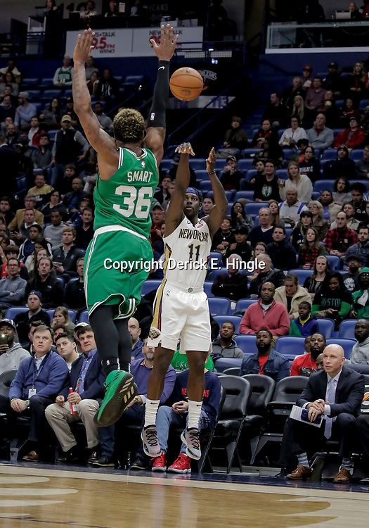 Nov 26, 2018; New Orleans, LA, USA; New Orleans Pelicans guard Jrue Holiday (11) shoots over Boston Celtics guard Marcus Smart (36) during the first quarter at the Smoothie King Center. Mandatory Credit: Derick E. Hingle-USA TODAY Sports