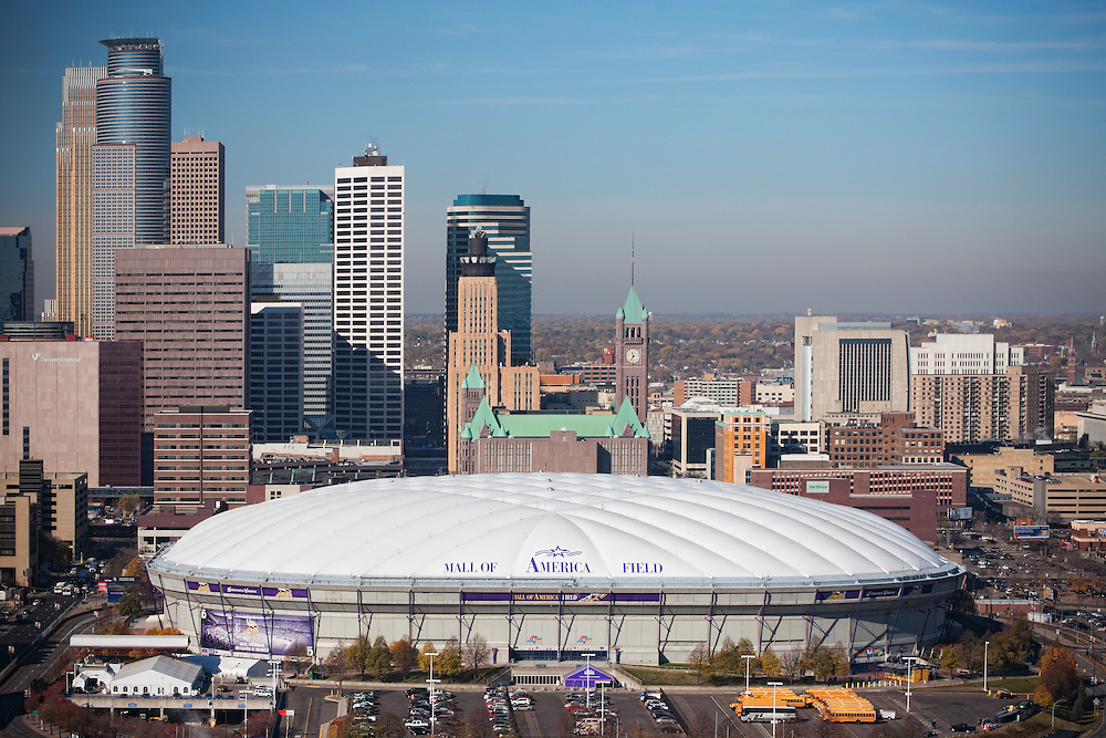 Minneapolis, MN - Nov 3, 2011 Minneapolis skyline and Mall of America field, home of The Minnesota Vikings NFL football team. Discussions are underway to replace the stadium, formerly known as the Metrodome, with a new stadium.