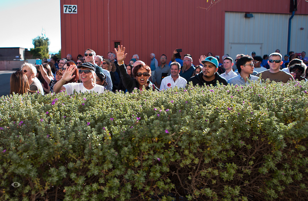 Supporters peer over the hedges for a glimpse of Hillary Clinton arriving for a rally at the UA Local 525 Plumbers and Pipefitters Union building on Wednesday, Nov. 2, 2016.  L.E. Baskow