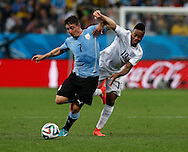 Cristian Rodr&iacute;guez of Uruguay and Raheem Sterling of England during the 2014 FIFA World Cup match at Arena Corinthians, Sao Paulo<br /> Picture by Andrew Tobin/Focus Images Ltd +44 7710 761829<br /> 19/06/2014