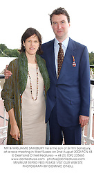 MR & MRS JAMIE SAINSBURY he is the son of Sir Tim Sainsbury, at a race meeting in West Sussex on 2nd August 2002.PCN 44