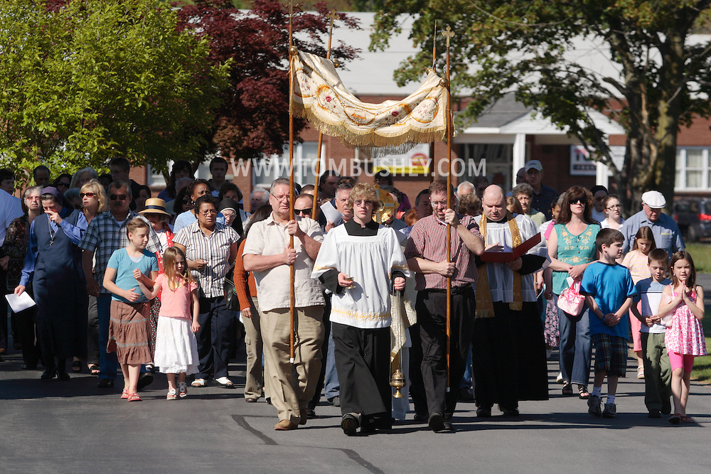 Middletown, NY - An altar boy leads parishioners as they march in a procession at St. Joseph's Church in Middletown on the feast of Corpus Christi, May 25, 2008.