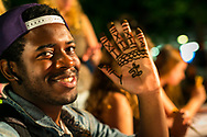 A student shows off his henna design at Sunburst Festival at Memorial Union in 2014.