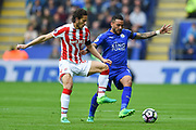 Stoke City midfielder Ramadan (32) battles with Leicester City defender Danny Simpson (17) during the Premier League match between Leicester City and Stoke City at the King Power Stadium, Leicester, England on 1 April 2017. Photo by Jon Hobley.