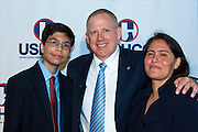 Revere MS STEM student Eduardo Corazon and his mother are congratulated by BP America CEO and President John Mingé at the U.S. Hispanic Chamber of Commerce Convention for winning first place in the school's science fair.