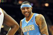 Jan. 28, 2011; Cleveland, OH, USA; Denver Nuggets power forward Kenyon Martin (4) laughs at a fan during the third quarter against the Cleveland Cavaliers at Quicken Loans Arena. The Nuggets beat the Cavaliers 117-103. Mandatory Credit: Jason Miller-US PRESSWIRE