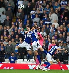 BIRMINGHAM, ENGLAND - Saturday, October 2, 2010: Birmingham City's Scott Dann and Nikola Zigic clash with each other during the Premiership match against Everton at St Andrews. (Photo by David Rawcliffe/Propaganda)