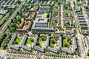 Nederland, Noord-Holland, Amsterdam, 14-06-2012; Slotervaart, Johan Huizingalaan (rechts), onder Robert Fruinlaan.  Het vierkant blok in het midden huisvest het Islamitisch College Amsterdam. Onder in beeld bouwblokken geplaatst onder een hoek in verband met de toetreding van zon. De flats staan aan de Robert Fruinlaan. ..De buurt is onderdeel van de Westelijke Tuinsteden, gerealiseerd op basis van het Algemeen Uitbreidingsplan voor Amsterdam (AUP, 1935). Voorbeeld van het Nieuwe Bouwen, open bebouwing in stroken, langwerpige bouwblokken afgewisseld met groenstroken. ..This residential area (Slotervaart) is an example of garden cities of Amsterdam-west. Constructed on the basis of the General Extension Plan for Amsterdam (AUP, 1935). Example of the New Building (het Nieuwe Bouwen), detached in strips, oblong housing blocks alternated with green areas, built in fifties and sixties of the 20th century. The square building (m) is the Islamitic College Amsterdam. The housing buildings (bottom) have been placed at an angle for the accession of sun...luchtfoto (toeslag), aerial photo (additional fee required).foto/photo Siebe Swart