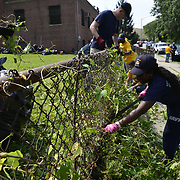 BRONX, NY - 8/18/2018 - U.S. Navy Chief Selects joined together with Chiefs and Senior Chiefs from Navy Operational Support Center New York to clean up the yard at Samuel H. Young American Legion Post 620 on Saturday as part of CPO365 Phase II.  (U.S. Navy Photo by Chief  Mass Communication Specialist Roger S. Duncan / RELEASED )