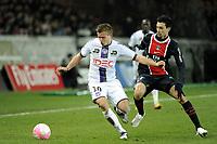 FOOTBALL - FRENCH CHAMPIONSHIP 2011/2012 - L1 - PARIS SAINT GERMAIN v TOULOUSE FC  - 14/01/2012 - PHOTO JEAN MARIE HERVIO / REGAMEDIA / DPPI - FRANCK TABANOU (TFC) / JAVIER PASTORE (PSG)