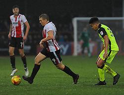 Troy Brown of Exeter City applies pressure on Danny Wright of Cheltenham Town  - Mandatory by-line: Nizaam Jones/JMP- 10/12/2016 - FOOTBALL - LCI Rail Stadium - Cheltenham, England - Cheltenham Town v Exeter City - Sky Bet League Two