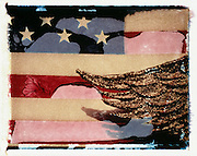 Polaroid transfer image of a United States flag with eagle wings