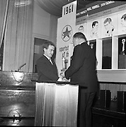 The Caltex Sports Stars of he Year recieved their trophies from An Taoiseach Mr. Seán Lemass T.D. at a dinner at the Gresham Hotal, Dublin.  Mr. Seán Lemass T.D. presents John Caldwell with his Caltex Sportstar of the year Award for boxing..01.02.1962