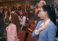 Goshen, New York - People recite the Pledge of Allegiance during a Naturalization ceremony at the Orange County Emergency Services Center on Nov. 17, 2016. A total of 86 people from 45 countries took the Oath of Allegiance and became citizens of the United States of America.