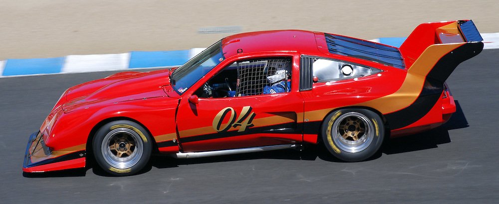 Vintage red and gold racecar, Laguna Seca