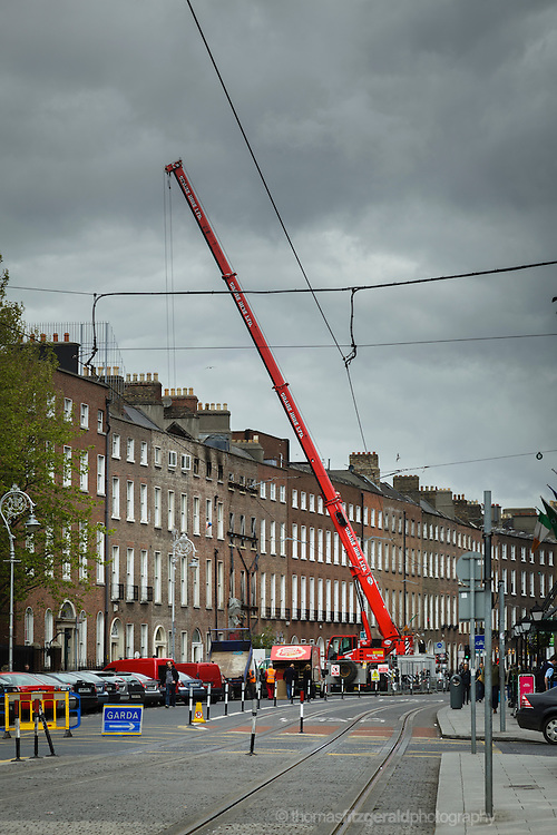 May 16, 2012: Dublin, Ireland: A crane lifts rubble from the burned remains of a building after a fire the previous day on Dublin's Harcourt Street. The road is still blocked off and you can see Garda signs for the diversion in place.