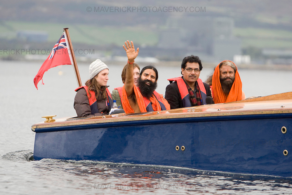 Swami Ji shows waves as he leaves the island..The worlds leading Yoga expert Swami Ji, co-founder of the Patanjali Yog Peeth Trust opens Scotlands new Yoga Island..Over a thousand people  joined in the 'Hawan' celebrations on the island of Little Cumbrae. ..Picture Michael Hughes/Maverick 27/9/09...i