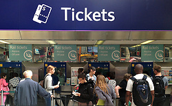 © Licensed to London News Pictures. 14/08/2012. London,UK.Customers queue for train tickets at a train station in London on August, 14, 2012 against today's announcement of a 6.2% increase in fairs due to take effect in January 2013..  Photo credit : Thomas Campean/LNP