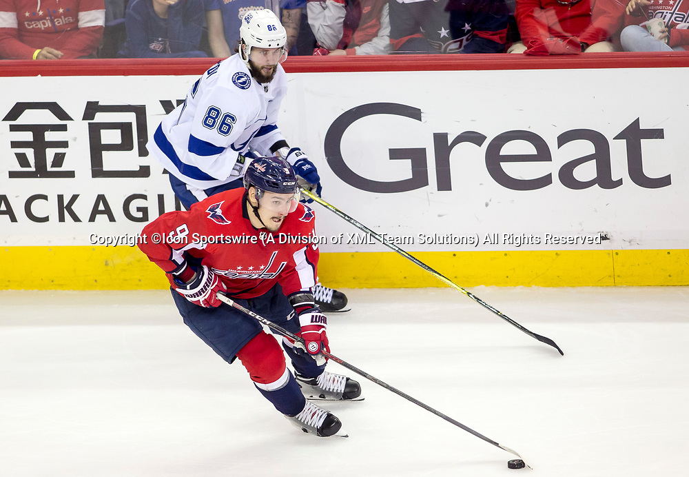 WASHINGTON, DC - MAY 21: Washington Capitals defenseman Dmitry Orlov (9) turns the puck away from Tampa Bay Lightning right wing Nikita Kucherov (86) during game 6 of the NHL Eastern Conference  Finals between the Washington Capitals and the Tampa Bay Lightning, on May 21, 2018, at Capital One Arena, in Washington D.C. The Caps defeated the Lightning 3-0<br /> (Photo by Tony Quinn/Icon Sportswire)