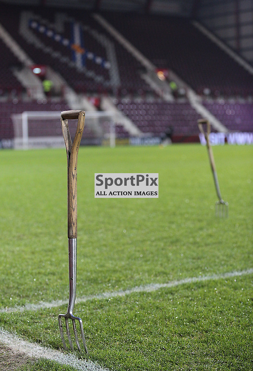 Hearts v Aberdeen Scottish Cup 9 January 2016; The forks are out to spike a sodden pitch before the Heart of Midlothian v Aberdeen William Hill Scottish Cup fourth round match played at Tynecastle Stadium, Edinburgh; <br /> <br /> &copy; Chris McCluskie | SportPix.org.uk