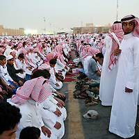 Young Saudi men during prayer at the Janadriya festival in Riyadh, an annual celebration of Saudi Arabian culture and traditions. March 2008.