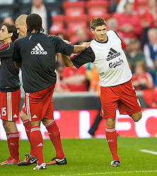 LIVERPOOL, ENGLAND - Monday, August 24, 2009: Liverpool's captain Steven Gerrard MBE warms-up before the Premiership match against Aston Villa at Anfield. (Photo by David Rawcliffe/Propaganda)