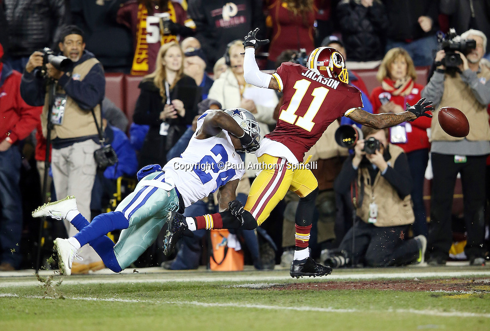 Washington Redskins wide receiver DeSean Jackson (11) reaches for an overthrown deep pass that goes incomplete while covered by diving Dallas Cowboys cornerback Morris Claiborne (24) in the first quarter during the 2015 week 13 regular season NFL football game against the Dallas Cowboys on Monday, Dec. 7, 2015 in Landover, Md. The Cowboys won the game 19-16. (©Paul Anthony Spinelli)