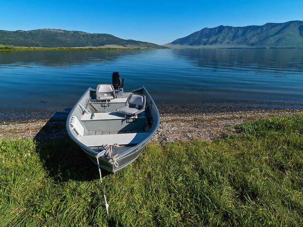 Beached fishing boat awaits a day of lake fishing on Henrys Lake a source of the Henrys Fork of the Snake River near Island Park in Eastern Idaho