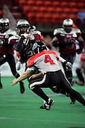 6-28-2007: Anchorage, AK - Alaska's Demarcus Morris (2) makes a cut past Barracuda Kyle Robinson (4) in the Alaska Wild 47 to 53 loss to the CenTex Barracudas at the Sullivan Arena...