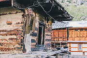 A Kinnauri man posing    out of his home in the small village of Chitkul