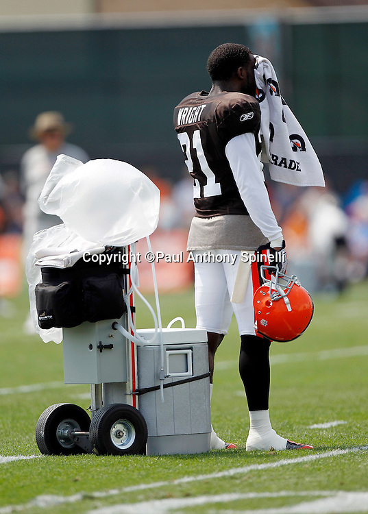 Cleveland Browns defensive back Eric Wright (21) wipes his face with a towel during NFL football training camp at the Cleveland Browns Training Complex on Monday, August 9, 2010 in Berea, Ohio. (©Paul Anthony Spinelli)