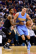 Jan 28, 2017; Phoenix, AZ, USA; Denver Nuggets forward Danilo Gallinari (8) handles the ball against Phoenix Suns forward Marquese Chriss (0) in the first half of the NBA game at Talking Stick Resort Arena. Mandatory Credit: Jennifer Stewart-USA TODAY Sports