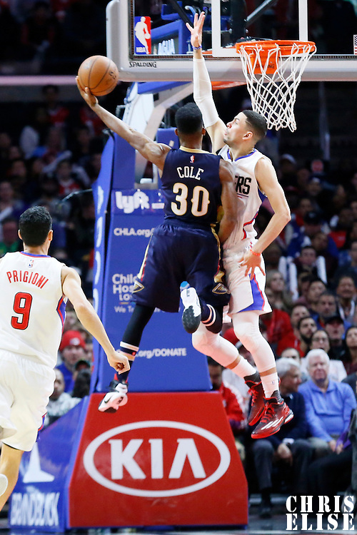 10 January 2016: New Orleans Pelicans guard Norris Cole (30) goes for the layup against Los Angeles Clippers guard Austin Rivers (25) during the Los Angeles Clippers 114-111 overtime victory over the New Orleans Pelicans, at the Staples Center, Los Angeles, California, USA.
