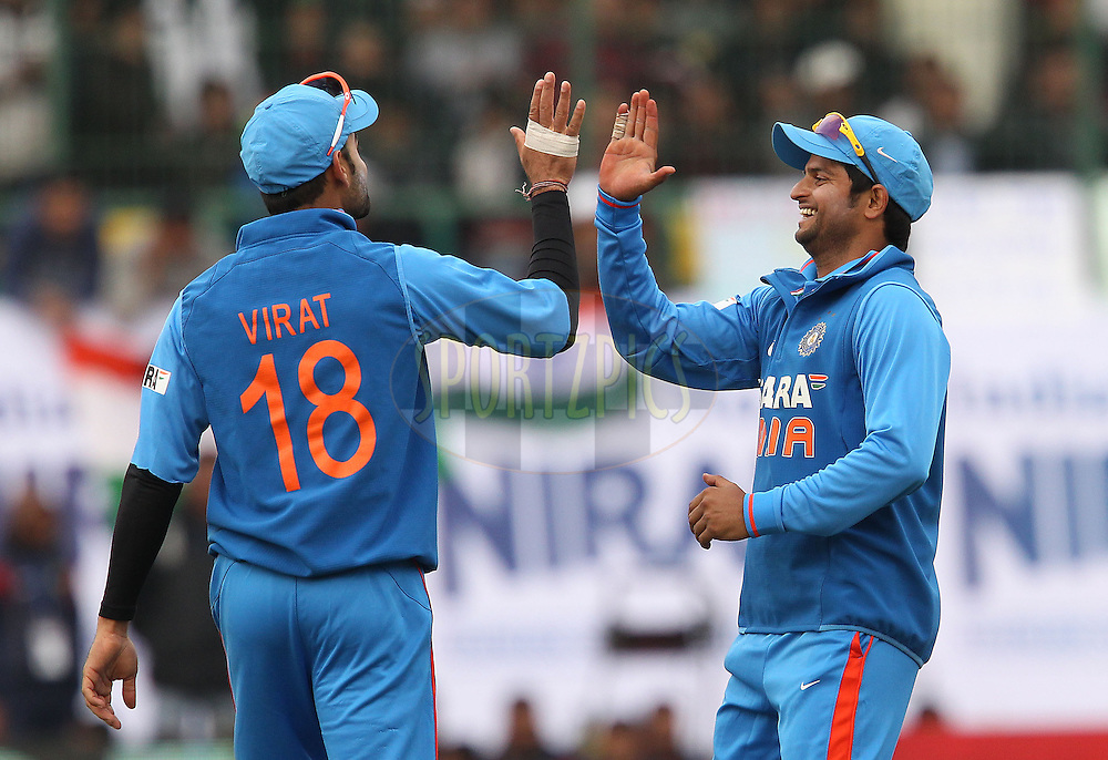 Virat Kohli of India and Suresh Raina of India during the 5th Airtel ODI between India and England held at the HPCA Stadium in Dharamsala, Himachal Pradesh, India on the 27th January 2013..Photo by Ron Gaunt/BCCI/SPORTZPICS ..Use of this image is subject to the terms and conditions as outlined by the BCCI. These terms can be found by following this link:..http://www.sportzpics.co.za/image/I0000SoRagM2cIEc