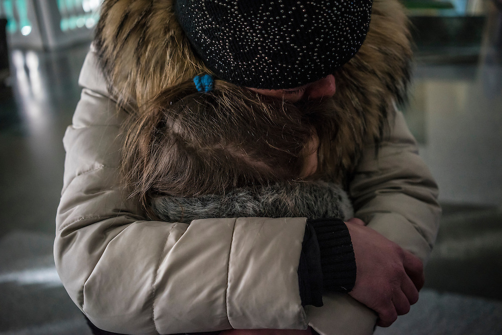 Irina Protsenko, displaced by fighting around the town of Debaltseve, hugs her daughter Diana upon the girl's arrival by train on Thursday, February 12, 2015 in Kharkiv, Ukraine. Irina has been in the hospital in Kharkiv with a spinal injury that prevents her from traveling; her three children arrived in Kharkiv by train as part of an organized evacuation of women and children, and saw their mother for the first time in weeks. The children will continue on from Kharkiv to the city of Lviv.