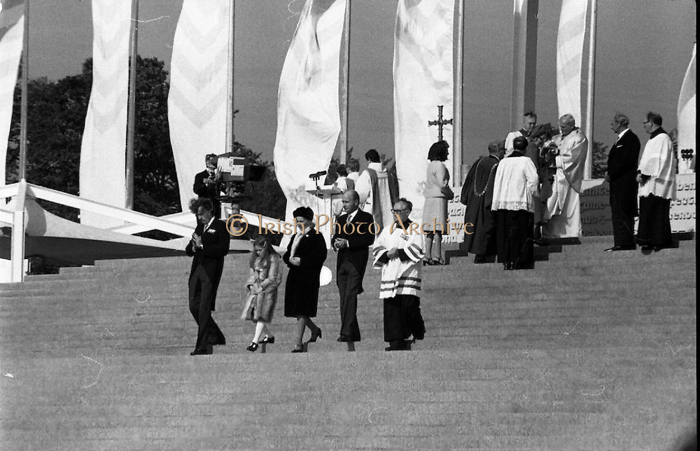 Pope John-Paul II visits Ireland..1979..29.09.1979..09.29.1979..29th September 1979..Today marked the historic arrival of Pope John-Paul II to Ireland. He is here on a three day visit to the country with a packed itinerary. He will celebrate mass today at a specially built altar in the Phoenix Park in Dublin. From Dublin he will travel to Drogheda by cavalcade. On the 30th he will host a youth rally in Galway and on the 1st Oct he will host a mass in Limerick prior to his departure from Shannon Airport to the U.S..Image of President and Mrs Hillery after they recieved Holy Communion.