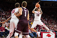 FAYETTEVILLE, AR - FEBRUARY 17:  Dustin Thomas #13 of the Arkansas Razorbacks goes up for a shot and is fouled from behind by Robert Williams #44 of the Texas A&M Aggies at Bud Walton Arena on February 17, 2018 in Fayetteville, Arkansas.  The Razorbacks defeated the Aggies 94-75.  (Photo by Wesley Hitt/Getty Images) *** Local Caption *** Dustin Thomas; Robert Williams