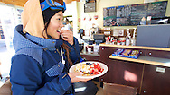 Chloe Kim finishes off the days training with a waffle from the Belgian Bean in Copper Mountain, CO. ©Brett Wilhelm/ESPN
