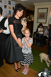 EVA LANSKA, her daughter MICHELLE and their dog Mimi at A Date With Your Dog At George in aid of the Dogs Trust held at George, 87-88 Mount Street, London on 9th September 2014.