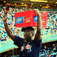 A vendor selling cold beer to the crowds at a baseball game at Yankee Stadium. Bronx, New York City.