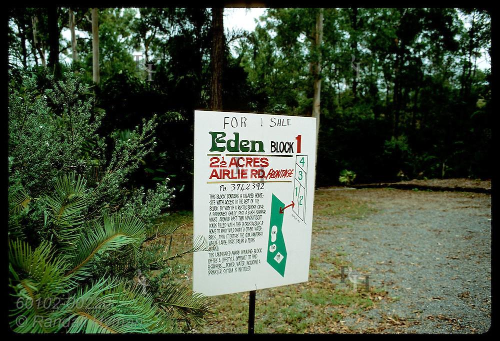 Koala habitat for sale: at edge of lush woodland sign advertises luxury home sites; Brisbane. Australia